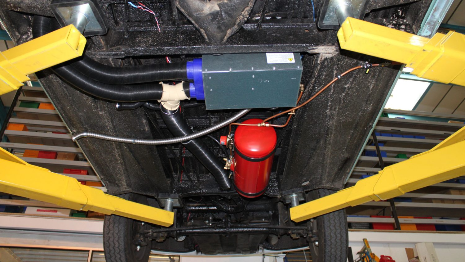 An underslung Gasit LPG tank fitted to a campervan.